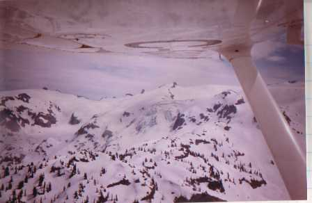 Glacier reflecting in aircraft wing near Garibaldi